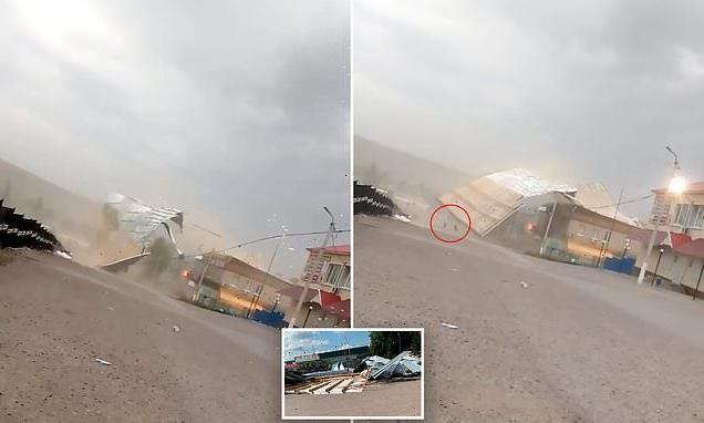 Terrifying moment roof smashes onto girl amid high winds in Russia
