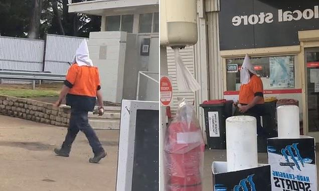 Tradie uses a Ku Klux Klan headpiece as a face mask in Sydney