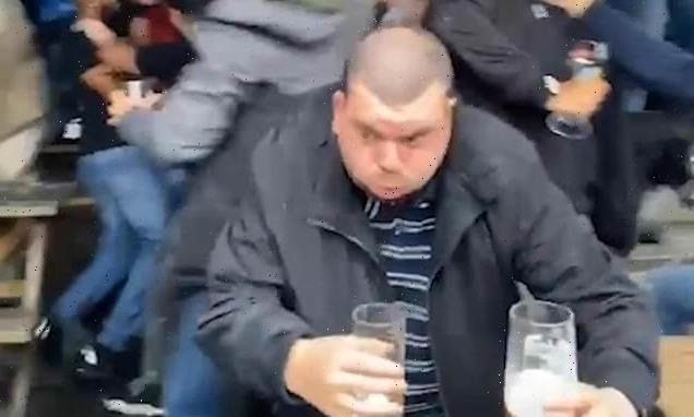 VIDEO: England fan saves his beer from jumping fans