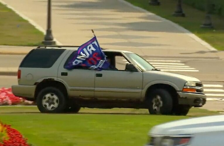 Woman waving Trump flag crashes Minnesota State Capitol event by 'speeding on lawn toward lawmakers'