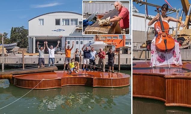 40ft boat in the shape of a giant VIOLIN launches in Venice
