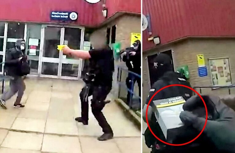 Dramatic moment armed cops snare hoax suicide bomber with cigarette after he threatened to blow up police station