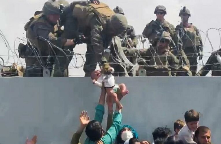 Heartbreaking moment crying baby handed to US soldier at Kabul airport as Afghans in race against time to flee Taliban
