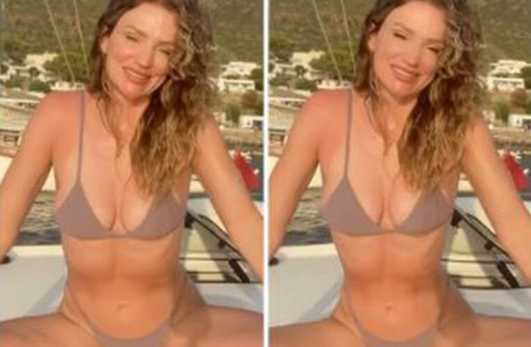 Influencer demonstrates how she can edit a bikini snap in SECONDS to trim down her waist and get rid of her cellulite