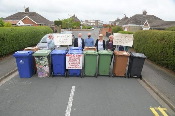 Livid locals to build ANOTHER wheelie-bin blockade to stop school-run parents parking across driveways