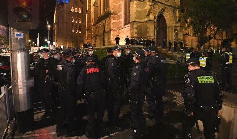 Victoria records 21 new cases as police arrest dozens of anti-lockdown protesters