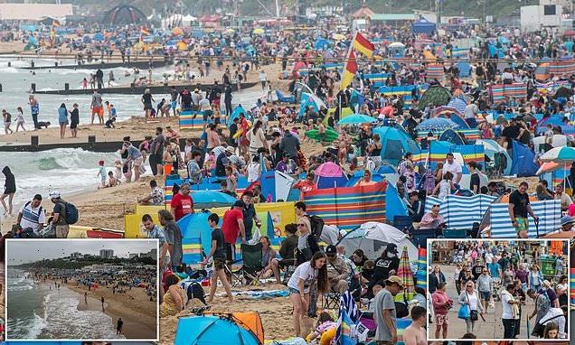 Crowds pack the beaches as temperatures get set to soar towards 86F