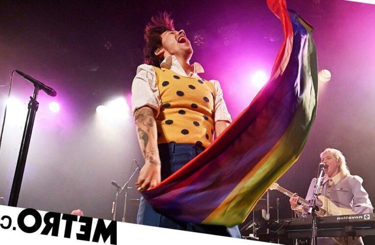 Harry Styles waves Pride flag on-stage as he kicks off tour in Las Vegas