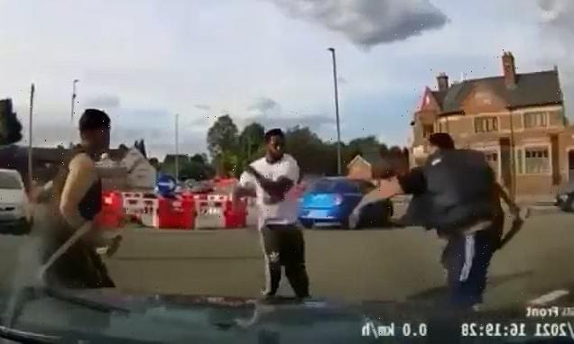Horrifying moment machete thugs attack rival on busy Birmingham road