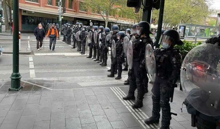 Riot police out in force as protest group marches into CBD
