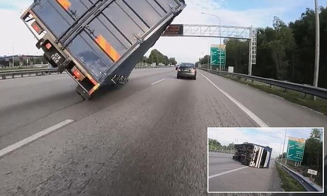 VIDEO: Malaysian driver flips over his truck