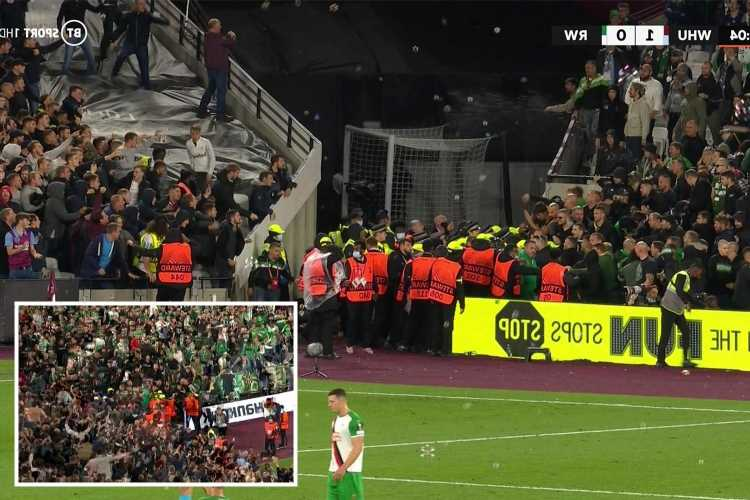 Violence erupts at West Ham as Rapid Vienna fans storm home end after Declan Rice opener with bottles also thrown