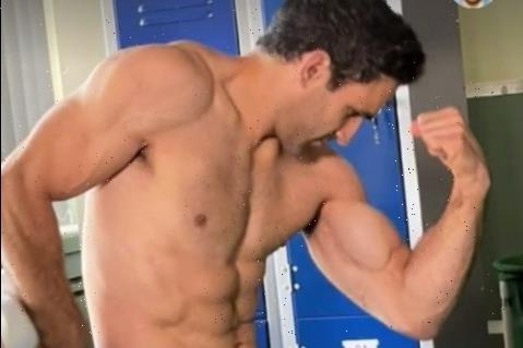 Ex EastEnders & Holby City star Davood Ghadami shows off rippling muscles as he poses topless in his scrubs