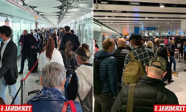 Hundreds queue for FOUR hours at Heathrow arrivals as e-gates crash