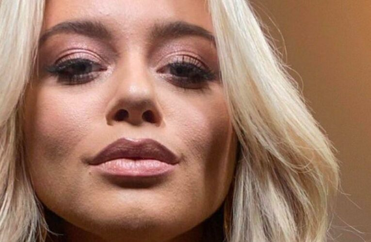 Im A Celebs Emily Atack puts on busty display in plunging top for sultry snap