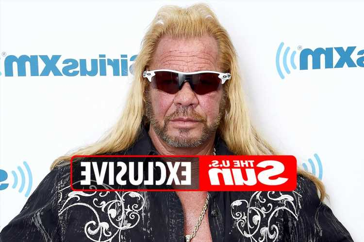 Moment Dog the Bounty Hunter is served $1.3M lawsuit during Brian Laundrie search over 'racist behavior'