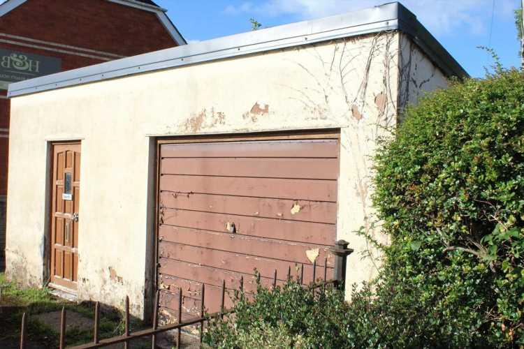Run-down old garage in Devon on sale for eye-watering £100,000 despite having no plumbing